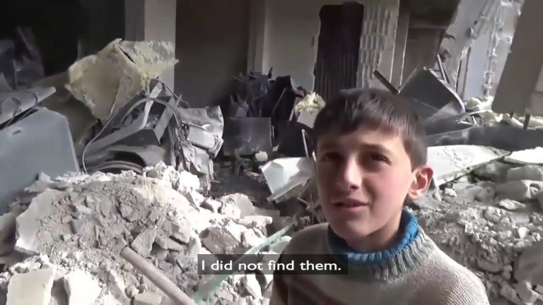 Syrian boy shows the destruction of his house in Eastern Ghouta